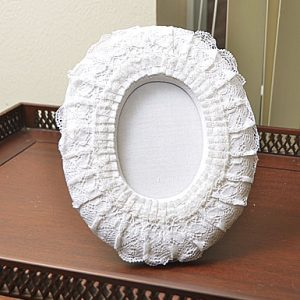 White Oval Lace picture frame. 9″x7″. Style # OF11D